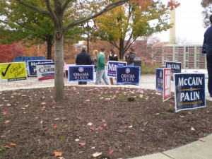 Like many other voters, Nicole Kelly had to walk past a slew of campaign signs outside of Kehr Union before voting.