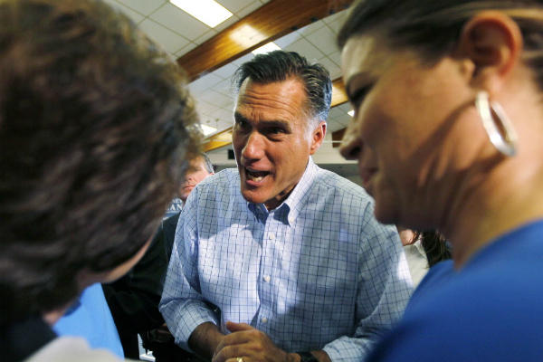 Republican presidential candidate Mitt Romney talks to two women after a campaign event in Golden, Colo., in August.