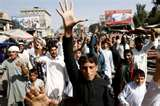 Afghan protesters march in Jalalabad, Afghanistan chanting anti-American phrases.