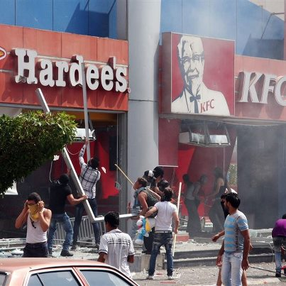 A Kentucky Fried Chicken and Hardee's restaurant was set on fire during a protest in Tripoli.