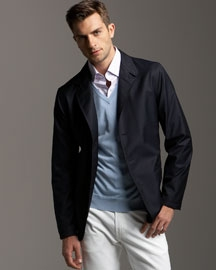 A casual dark blazer contrasting with a white trouser pants makes for an impressionable ensemble.