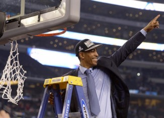 UConn Head Coach, Kevin Ollie, cutting down the net after winning the 2014 NCAA Championship.
