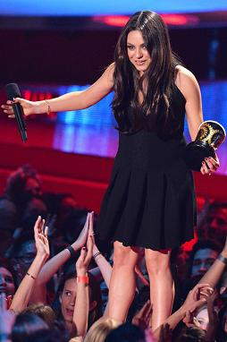 Mila Kunis after accepting the award for Best Villain (photo from www.eonline.com)
