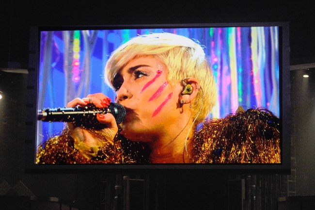 """Miley Cyrus performing """"Lucy In The Sky With Diamonds"""" (photo from www.billboard.com Ethan Miller/Getty Images)"""