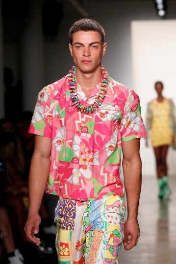 A male model wearing Jeremy Scott's clothing design and a Miley Cyrus accessory.