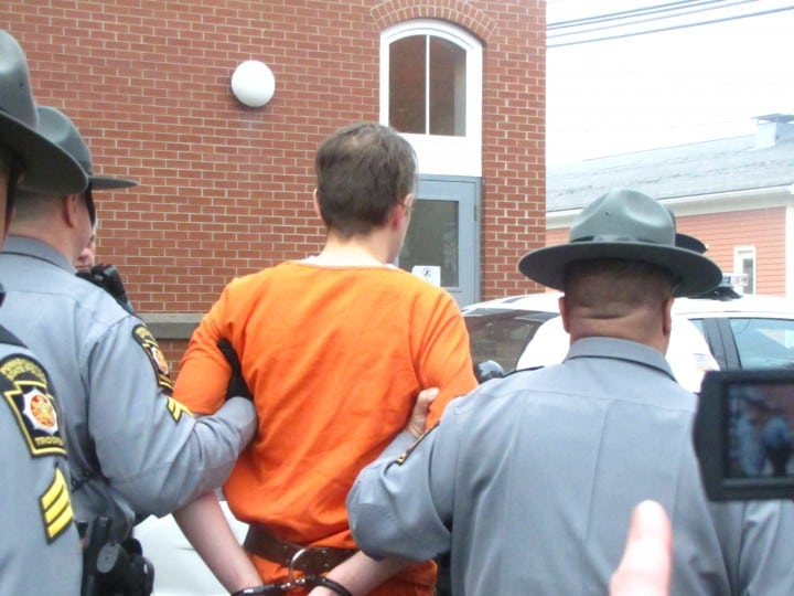 Eric Frein arriving at the awaiting Police Cruiser at the Pike County Court House.