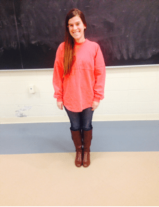 Becca is rocking her bright and fun spirit jersey, paired with dark wash jeans and riding boots.