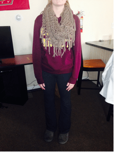 Kasey is sporting Bloomsburg attire with her maroon sweatshirt, fringed scarf, and comfortable yoga pants.