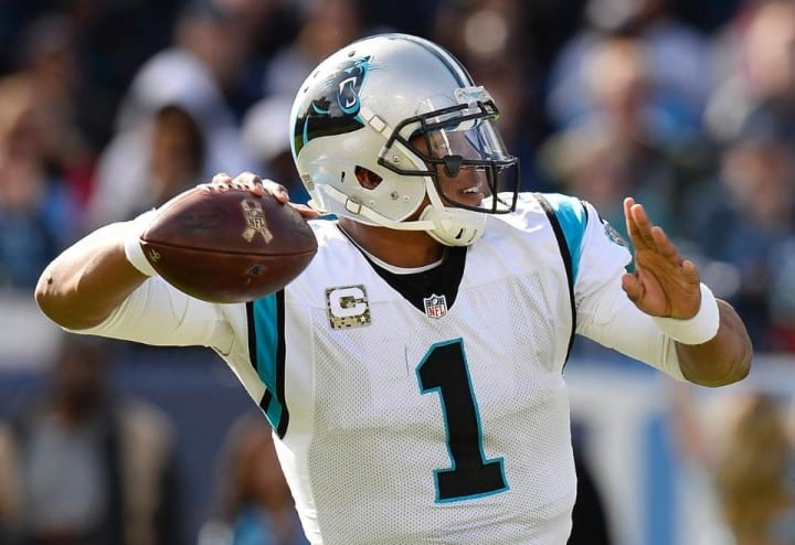 Carolina Panthers quarterback Cam Newtown passes for a touchdown against Tennessee Titans