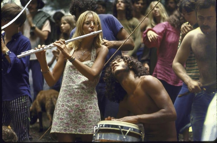 Shirtless male drummer & dress-wearing female flutist jamming during Woodstock music festival. (Photo by Bill Eppridge//Time Life Pictures/Getty Images)