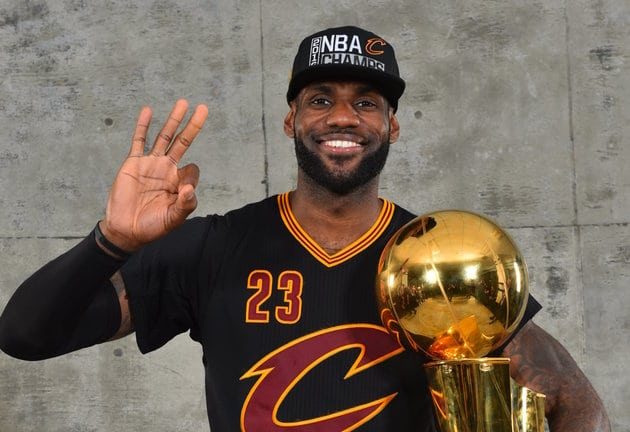 OAKLAND, CA - JUNE 19: LeBron James #23 of the Cleveland Cavaliers poses for a portrait with the World Championship Trophy after winning the NBA Championship against the Golden State Warriors during the 2016 NBA Finals Game Seven on June 19, 2016 at ORACLE Arena in Oakland, California. NOTE TO USER: User expressly acknowledges and agrees that, by downloading and or using this photograph, User is consenting to the terms and conditions of the Getty Images License Agreement. Mandatory Copyright Notice: Copyright 2016 NBAE (Photo by Jesse D. Garrabrant/NBAE via Getty Images)