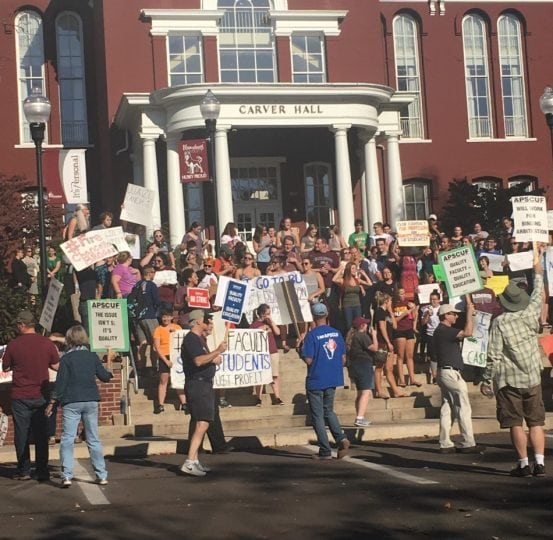 Students join faculty in their protest