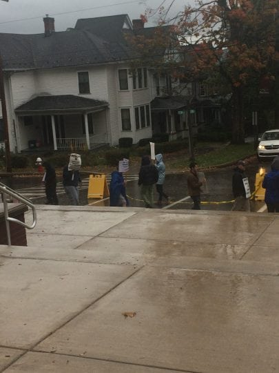 Even heavy rain will not stop these faculty members from participating in the picket line