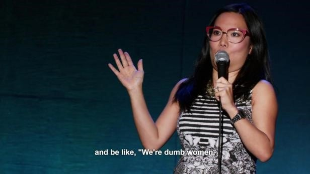Ali Wong on stage discussing why feminism is an issue.