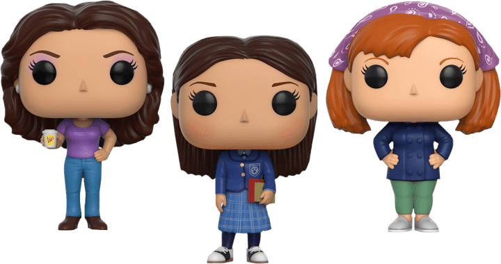 From left to right:Lorelai Gilmore Pop figurine, Rory Gilmore Pop figurine, and Sookie St. James Pop figurine