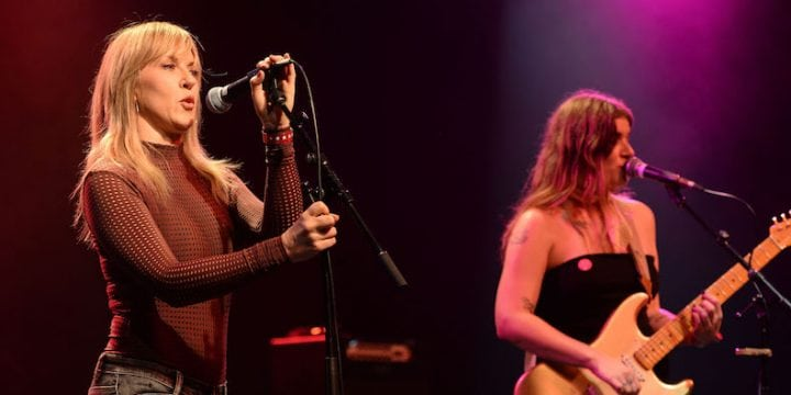 """Singers Liz Phair (L) and Bethany Cosentino (R) of Best Coast perform onstage during the """"Don't Site Down: Planned Parenthood Benefit Concert."""" (Photo by Scott Dudelson/Getty Images)"""