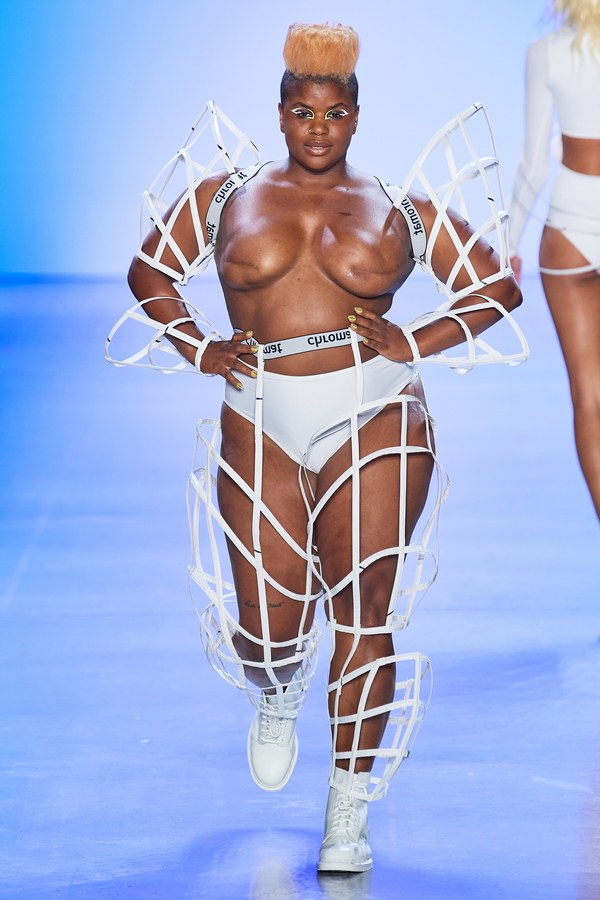 Model Ericka Hart walks the runway in a signature Chromat architectural cage.