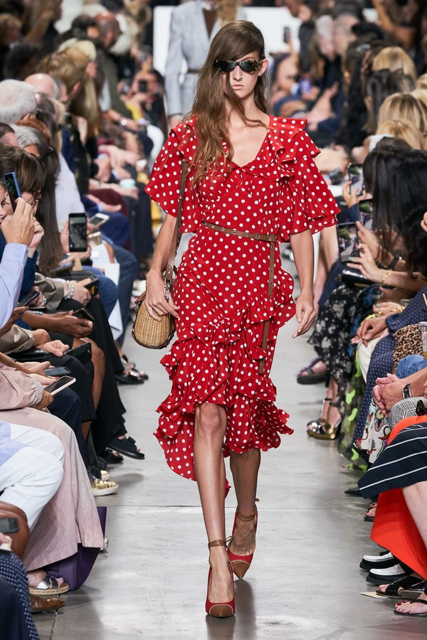 Model walks the runway for Michael Kors ss20 collection.