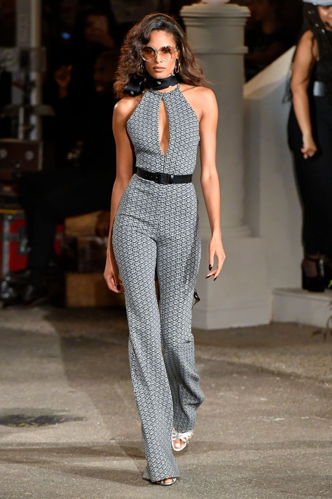 Model walks the runway in Tommy X Zendaya ss20 collection.